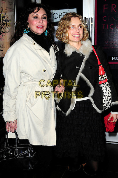 MARIE HELVIN & MIRIAM D'ABO.An Academy Tribute To Jeremy Thomas,.Curzon Soho,Shaftesbury Avenue, London, England..November 25th 2010.half 3/4 length black trousers grey gray mac coat jacket scarf fur lined sheepskin dalmatian leopard print bag purse  dress tights  .CAP/CAS.©Bob Cass/Capital Pictures.