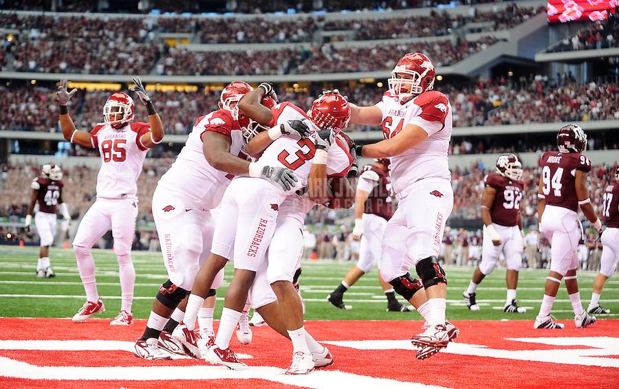 Oct. 9, 2010; Arlington, TX, USA; Arkansas Razorbacks wide receiver (3) Joe Adams celebrates with teammates after catching a touchdown pass in the first quarter against the Texas A&M Aggies at Cowboys Stadium. Mandatory Credit: Mark J. Rebilas-