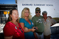 San Diego, CA, Saturday, September 06 2008:  Friends of Rosa Lisowski wear buttons with the missing woman's image on them before a press conference at Barnard Elementary School to comment on the arrest of her husband, Henry.   Lisowski was arrested at his home in Ocean Beach last Friday night.  Rosa Lisowski has not been seen since she dropped her son off at the Barnard Elemtary school on the morning of Monday March 24 2008.  From left,  Janet Boyd., Heather Peterson, Arthur Eischens and Cheryl Eischens.