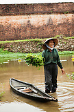 VIETNAM, Hue, Nguyen Thi Ngan picks a leafy green vegetable called rau muong in the Citadel canal