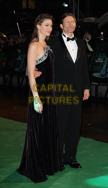 CRISPIN GLOVER & WIFE.World Premiere of 'Alice In Wonderland' at the Odeon, Leicester Square, London, England..February 25th, 2010.full length black dress tuxedo tux bow tie couple silver diamante sparkly trim profile married husband .CAP/ROS.©Steve Ross/Capital Pictures.