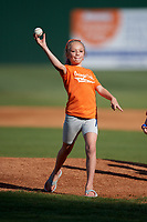 A young fan throws out a first pitch before an Elizabethton Twins game against the Bristol Pirates on July 28, 2018 at Joe O'Brien Field in Elizabethton, Tennessee.  Elizabethton defeated Bristol 5-0.  (Mike Janes/Four Seam Images)