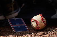 A tattered baseball sits on the ground near the gear bag of Brian Sondergard (not pictured) prior to the game against the High Point Panthers at Williard Stadium on February 18, 2017 in High Point, North Carolina. The Panthers defeated the Highlanders 11-0 in game one of a double-header. (Brian Westerholt/Four Seam Images)