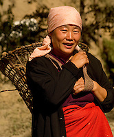A lady from nagaland on her way to the market with a head strap basket. Nagaland, India
