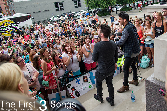 Dan Smyers and Shay Mooney of Dan + Shay performs on Day One of the 2014 CMA Music Festival in Nashville, Tennessee.