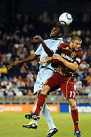 Birahim Diop Sporting KC  and Chris Wingert (17) Real Salt Lake go up for a header... Sporting Kansas City defeated Real Salt Lake 2-0 at LIVESTRONG Sporting Park, Kansas City, Kansas.