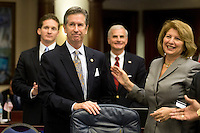TALLAHASSEE, FLA. 5/3/13-SESSIONEND050313CH-Rep. Jim Boyd, R-Bradenton, left, is joined by Rep. Janet Cruz, D-Tampa, right, after the election reform bill passed the House during the final day of the legislative session May 3, 2013 at the Capitol in Tallahassee. The bill now heads to the Senate...COLIN HACKLEY PHOTO