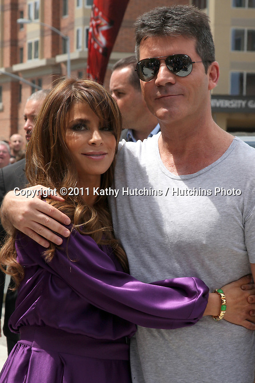 "LOS ANGELES - MAY 8:  Paula Abdul & Simon Cowell , two of the talent judges arriving at the ""X-Factor Auditions"" at Galen Center on May 8, 2011 in Los Angeles, CA"