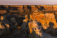 Sunrise view of unique colorful pillars and columns of Coal Mine Canyon, near Tuba City, Arizona. Part of Moenkopi Wash, and Hopi and Navajo Reservations.