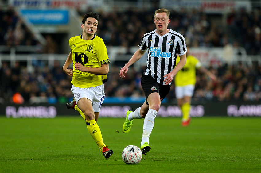 Blackburn Rovers' Lewis Travis vies for possession with Newcastle United's Sean Longstaff<br /> <br /> Photographer Alex Dodd/CameraSport<br /> <br /> Emirates FA Cup Third Round - Newcastle United v Blackburn Rovers - Saturday 5th January 2019 - St James' Park - Newcastle<br />  <br /> World Copyright © 2019 CameraSport. All rights reserved. 43 Linden Ave. Countesthorpe. Leicester. England. LE8 5PG - Tel: +44 (0) 116 277 4147 - admin@camerasport.com - www.camerasport.com