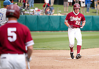 STANFORD, CA - April 23, 2011: Brian Guymon of Stanford baseball crosses the plate for the first run of the ninth inning during Stanford's game against UCLA at Sunken Diamond. Stanford won 5-4.