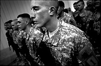 A U.S. soldier from the 2nd battalion, 32nd Field Artillery brigade sweats as his commander announces that their mission in Iraq is extended for another three months at the Liberty camp in Baghdad on August 3, 2007.