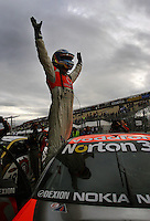 Jamie Whincup celebrates winning Race Two during Day Three of the Hamilton 400 Aussie V8 Supercars Round Two at Frankton, Hamilton, New Zealand on Sunday, 19 April 2009. Photo: Dave Lintott / lintottphoto.co.nz