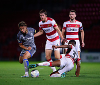 Lincoln City's Tyler Walker vies for possession with Doncaster Rovers' Tom Anderson, centre, and Doncaster Rovers' Cameron John<br /> <br /> Photographer Andrew Vaughan/CameraSport<br /> <br /> EFL Leasing.com Trophy - Northern Section - Group H - Doncaster Rovers v Lincoln City - Tuesday 3rd September 2019 - Keepmoat Stadium - Doncaster<br />  <br /> World Copyright © 2018 CameraSport. All rights reserved. 43 Linden Ave. Countesthorpe. Leicester. England. LE8 5PG - Tel: +44 (0) 116 277 4147 - admin@camerasport.com - www.camerasport.com