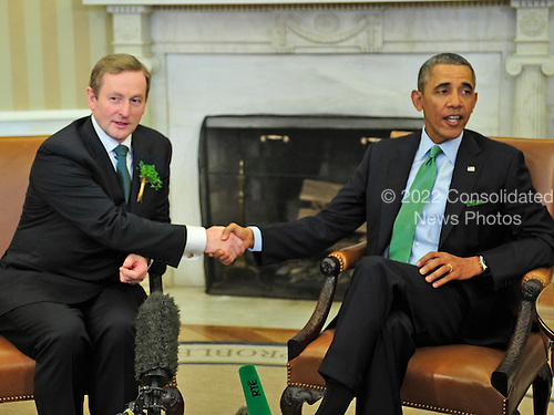 United States President Barack Obama, right, shakes hands with Prime Minister Enda Kenny of Ireland in the Oval Office of the White House in Washington, D.C. on Friday, March 14, 2014.<br /> Credit: Ron Sachs / Pool via CNP