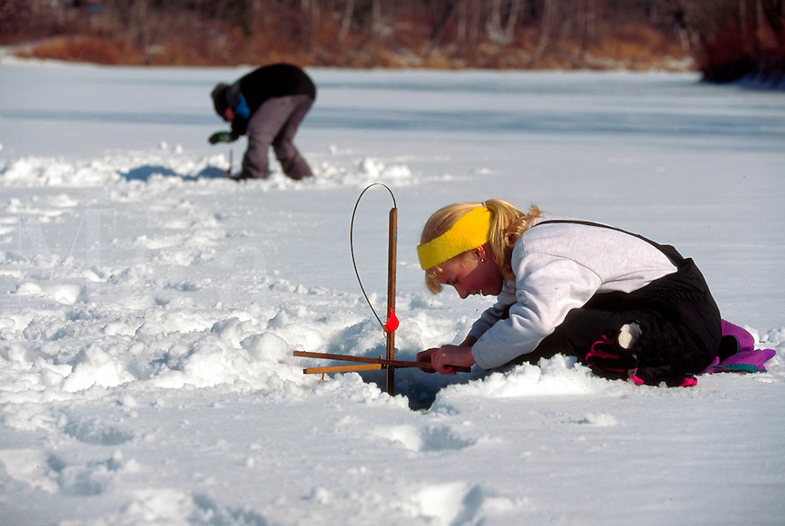 Girl ice fishing. Vermont.