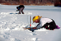 Girl ice fishing. Vermont.