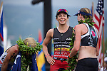 KONA-KAILUA, HI - OCTOBER 11:  Mirinda Carfrae of Australia, Daniela Ryf of Switzerland, and Rachel Joyce of Great Britain at the finish line at the 2014 IRONMAN Triathlon World Championships presented by GoPro on October 11, 2014 in Kailua-Kona, Hawaii. (Photo by Donald Miralle) *** Local Caption ***