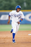 Christian Cano (30) of the Burlington Royals hustles towards third base against the Johnson City Cardinals at Burlington Athletic Park on July 14, 2014 in Burlington, North Carolina.  The Cardinals defeated the Royals 9-4.  (Brian Westerholt/Four Seam Images)