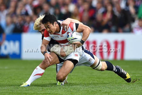 Kenki Fukuoka of Japan is tackled to ground by Richie Gray of Scotland. Rugby World Cup Pool B match between Scotland and Japan on September 23, 2015 at Kingsholm Stadium in Gloucester, England. Photo by: Patrick Khachfe / Onside Images