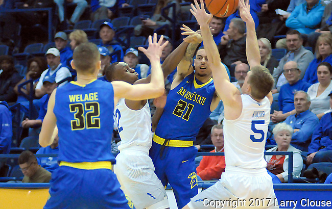 January 14, 2017:  San Jose guard, Jalen James #21, makes a pass in heavy traffic during the NCAA basketball game between the San Jose State Spartans and the Air Force Academy Falcons, Clune Arena, U.S. Air Force Academy, Colorado Springs, Colorado.  San Jose State defeats Air Force 89-85.