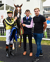 Winner of The Tony Brown's 75th Birthday Handicap, Dandy Flame ridden by Finley Marsh and trained by Richard Hughes  in the winners enclosure during Ladies Evening Racing at Salisbury Racecourse on 15th July 2017
