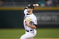Charlotte Knights relief pitcher Spencer Adams (12) in action against the Toledo Mud Hens at BB&T BallPark on April 23, 2019 in Charlotte, North Carolina. The Knights defeated the Mud Hens 11-9 in 10 innings. (Brian Westerholt/Four Seam Images)