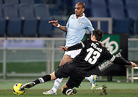 Calcio, semifinale di ritorno di Coppa Italia: Lazio vs Juventus. Roma, stadio Olimpico, 29 gennaio 2013..Lazio defender Abdoulay Konko, of France, is tackled by Juventus defender Federico Peluso, right, during the Italy Cup football semifinal return leg match between Lazio and Juventus at Rome's Olympic stadium, 29 January 2013..UPDATE IMAGES PRESS/Riccardo De Luca