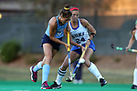 16 October 2015: North Carolina's Emily Wold (9) and Duke's Aileen Johnson (24). The University of North Carolina Tar Heels hosted the Duke University Blue Devils at Francis E. Henry Stadium in Chapel Hill, North Carolina in a 2015 NCAA Division I Field Hockey match. UNC won the game 2-1.