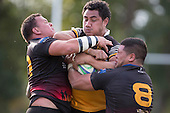 Maake Vaimohea gets wrapped up by Robert Katu and Pirikamu Enua. Counties Manukau Premier Club rugby game between Te Kauwhata and Onewhero, played at Te Kauwhata on Saturday April 16th 2016. Onewhero won the game 37 - 0 after leading 13 - 0 at Halftime. Photo by Richard Spranger.