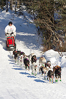 Musher Justin Savidis on Long Lake at the Re-Start of the 2011 Iditarod Sled Dog Race in Willow, Alaska.
