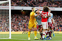 Thomas Heaton of Aston Villa raises a hand to Mattéo Guendouzi of Arsenal during the Premier League match between Arsenal and Aston Villa at the Emirates Stadium, London, England on 22 September 2019. Photo by Carlton Myrie / PRiME Media Images.
