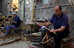 Palestinian men work on bamboo furniture at workshop in Gaza city on June 13, 2019. Bamboo has a long history of use in furniture. Bamboo is a product of southeast Asian countries and before the Israeli blockade of the Gaza Strip, Gaza traders used to bring it in to the coastal territory in adequate quantities to allow the industry to remain viable. Photo by Mahmoud Ajjour