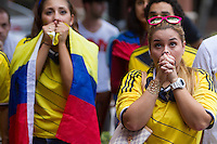 Miami, FL - Friday, July 4, 2014: Colombian fans hope for a goal while watching the Brazil vs. Colombia Quarterfinal World Cup match in the Brickell neighborhood.