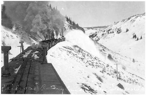 Rotary being pushed by four light engines somewhere on Cumbres Pass.<br /> D&amp;RGW  Cumbres Pass, CO