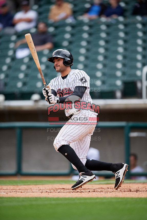 Birmingham Barons first baseman Nick Basto (25) follows through on a swing during a game against the Jacksonville Jumbo Shrimp on April 24, 2017 at Regions Field in Birmingham, Alabama.  Jacksonville defeated Birmingham 4-1.  (Mike Janes/Four Seam Images)