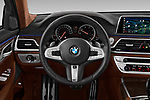 Car pictures of steering wheel view of a 2018 BMW 7 Series M Sport 4 Door Sedan