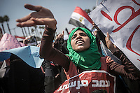 In this Friday, Jul. 05, 2013 photo, a woman member of the Muslim Brotherhood shouts slogans as she rallies at Cairo University after praying against the military's coup in Cairo, Egypt. (Photo/Narciso Contreras).