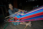 A woman weave cloth in Tuingo, an ethnic Chin village in Myanmar.