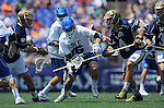 26 MAY 2014:  Stephen O'Hara (4) of the Notre Dame Fighting Irish breaks his stick defending against Jack Bruckner (36) of the Duke Blue Devils during the Division I Men's Lacrosse Championship at M&T Bank Stadium in Baltimore, MD. Larry French/NCAA Photos
