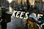Bicycle lamp by a canal - winter's day in Amsterdam. Self portrait
