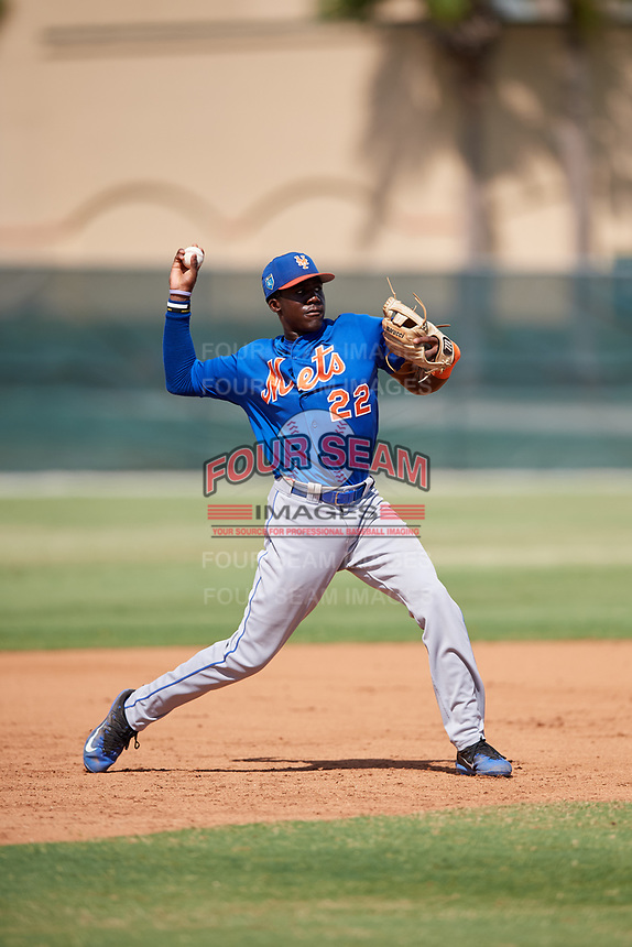 GCL Mets third baseman Jaylen Palmer (22) throws to first base during a game against the GCL Cardinals on August 6, 2018 at Roger Dean Chevrolet Stadium in Jupiter, Florida.  GCL Cardinals defeated GCL Mets 6-3.  (Mike Janes/Four Seam Images)