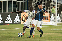 FOXBOROUGH, MA - JULY 27:  Lamine Sane #22 and Gustavo Bou #7 compete for the ball at Gillette Stadium on July 27, 2019 in Foxborough, Massachusetts.