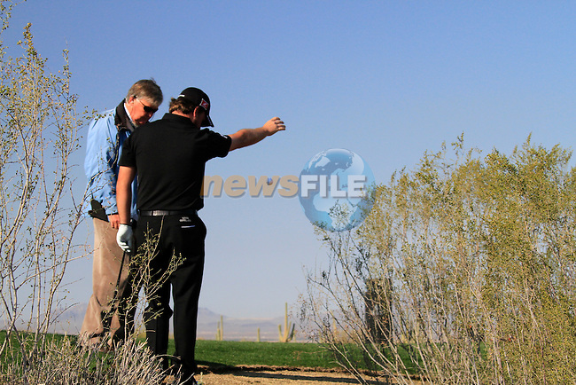Graeme McDowell in trouble on the 1st hole during Day 2 of the Accenture Match Play Championship from The Ritz-Carlton Golf Club, Dove Mountain. (Photo Eoin Clarke/Golffile 2011)