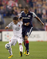 DC United midfielder Andy Najar (14) traps the ball as New England Revolution forward Khano Smith (18) pressures. The New England Revolution defeated DC United, 1-0, at Gillette Stadium on August 7, 2010.