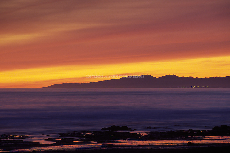 Sunset over Pacific Ocean, viewed from Coal Oil Point, Santa Barbara County, CA.