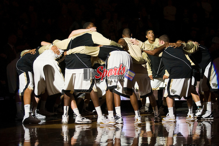 The Wake Forest Demon Deacons huddle up during player introductions prior to playing against the North Carolina State Wolfpack at the Lawrence Joel Veterans Memorial Coliseum December 20, 2009, in Winston-Salem, North Carolina.  The Demon Deacons defeated the Wolfpack 67-59.  Photo by Brian Westerholt / Sports On Film