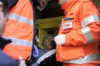 Roma, 12 Aprile 2012.Ministero del Lavoro.Via Fornovio.Manifestazione degli operai Sirti contro i licenziamenti..I carabinieri e la polizia caricano e respingono con i manganelli i lavoratori..un operaio ferito dai manganelli della polizia viene portato in ospedale