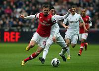 Pictured L-R: Carl Jenkinson of Arsenal against Pablo Hernandez of Swansea.  Saturday 16 March 2013<br /> Re: Barclay's Premier League, Swansea City FC v Arsenal at the Liberty Stadium, south Wales.