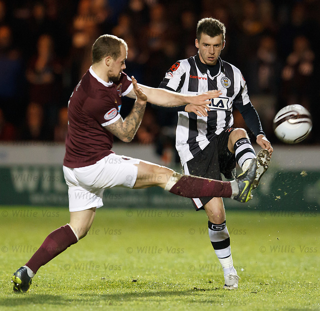 Jamie Hamill and Graham Carey go for the ball